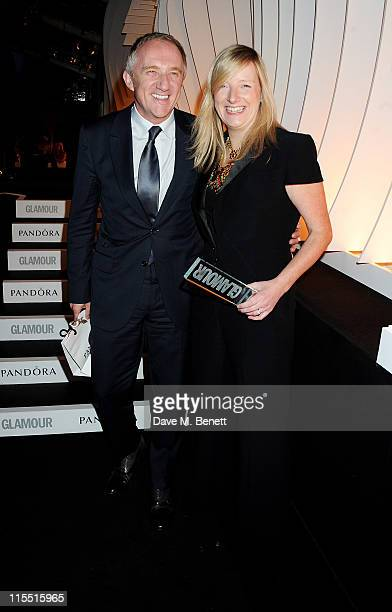 FrancoisHenri Pinault and Designer of the Year winner Sarah Burton pose at the Glamour Women of the Year Awards at Berkeley Square Gardens on June 7...