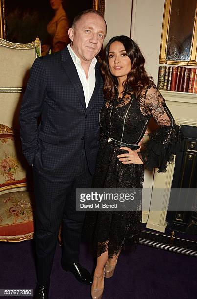 FrancoisHenri Pinault and Salma Hayek attend the Gucci party at 106 Piccadilly in celebration of the Gucci Cruise 2017 fashion show on June 2 2016 in...
