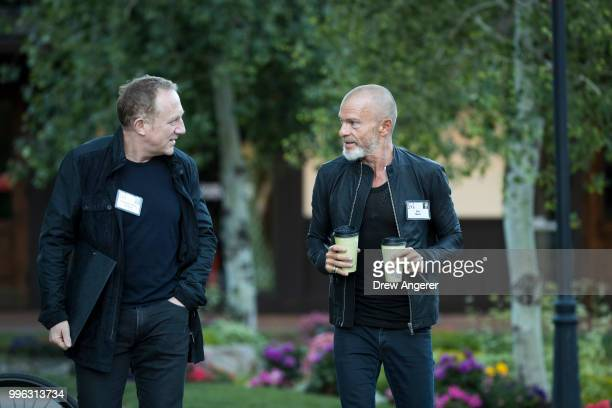 FrancoisHenri Pinault chief executive officer of Kering and venture capitalist Aviv 'Vivi' Nevo arrive for a morning session of the annual Allen...