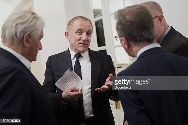 Francois-Henri Pinault, chief executive officer of Kering SA, center, speaks with attendees during a luxury partnership event at HEC business school...
