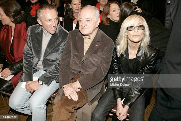 FrancoisHenri Pinault Pierre Berge and Betty Catroux at the Yves Saint Laurent fashion show as part of Paris Fashion Week Spring/Summer 2005 on...
