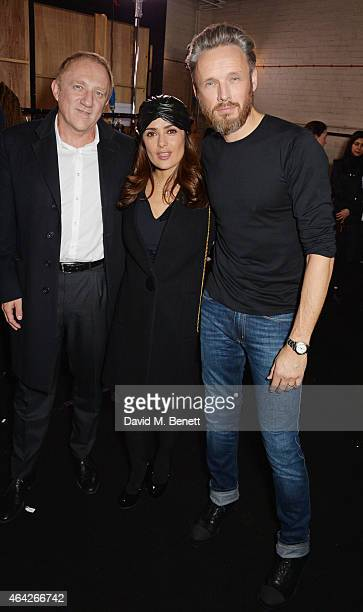 FrancoisHenri Pinault Salma Hayek and Hunter Creative Director Alasdhair Willis attend the Hunter Original AW15 catwalk show during London Fashion...