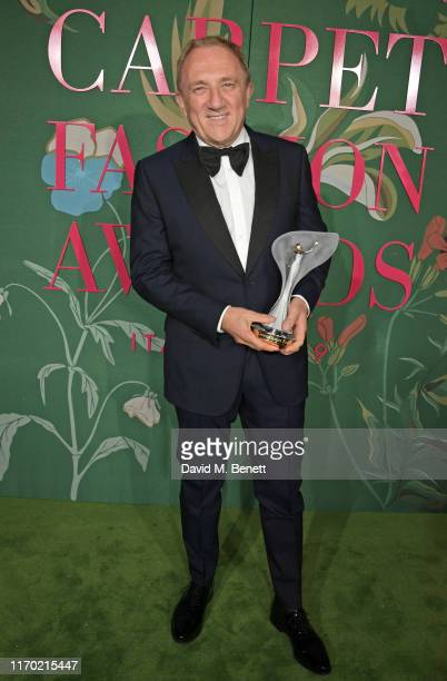 FrancoisHenri Pinault winner of THE GCFA Visionary Award poses in the Winners Room at The Green Carpet Fashion Awards Italia 2019 hosted by CNMI...