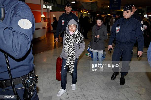 FrancoPakistani girl Amena Tarar arrives with her mother Ingrid B at Roissy Charles de Gaulle airport on February 18 2012 Kidnapped 7 years ago by...