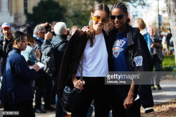 Francophone models Camille Hurel and Karly Loyce pose after the Chanel show during Paris Fashion Week Spring/Summer 2018 on October 3 2017 in Paris...