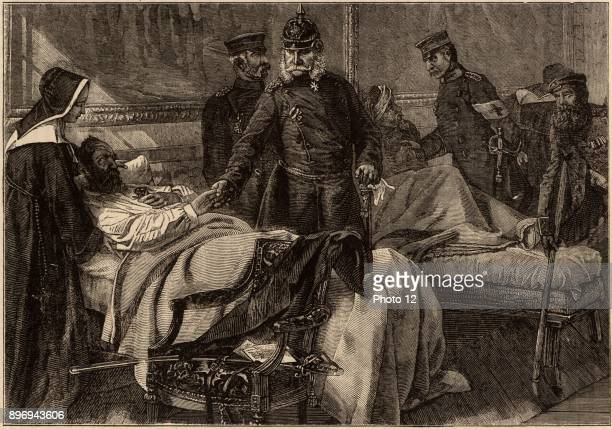FrancoPrussian War 18701871 Wilhelm I king of Prussia and first Emperor of Germany visiting wounded German troops being nursed in the Palace of...