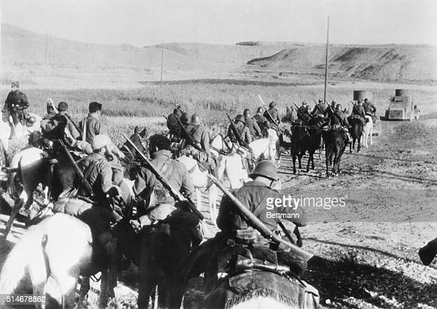 Franco's cavalry approaches Madrid lead by two armored cars Spain November 1936 | Location near Madrid Spain