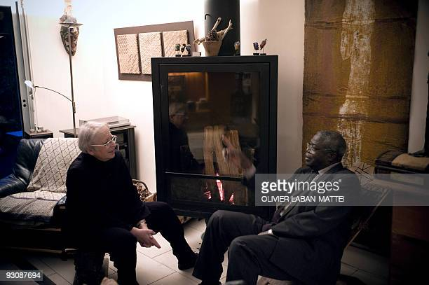 Franco-Togolese dual national politician Kofi Yamgnane chats with his wife Anne-Marie at their house of Saint-Coulitz, western France, on November...