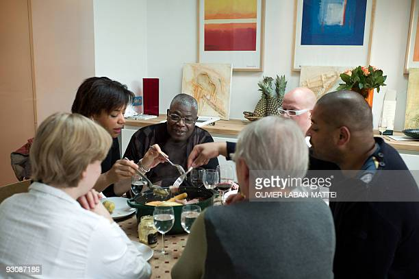 Franco-Togolese dual national politician Kofi Yamgnane , his wife Anne-Marie and their daughter Amina share a meal at the house of their son Kwame on...
