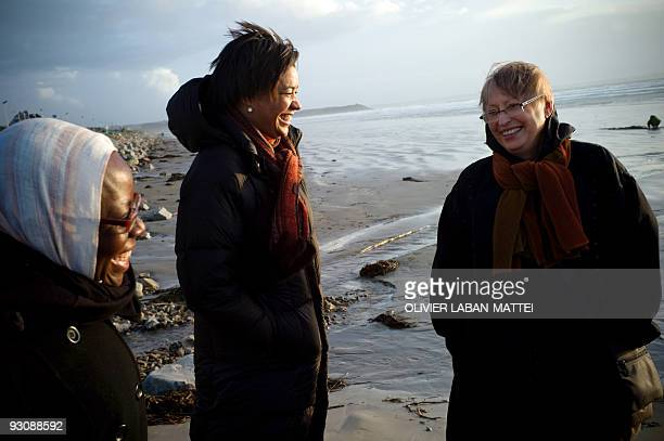 Franco-Togolese dual national politician Kofi Yamgnane's wife Anne-Marie chats with their daughter Amina on the beach of Saint-Nic, western France,...