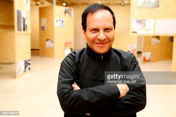 FrancoTunisian fashion designer Azzedine Alaia poses during an exposition of Britain's artist Richard Wentworth photographic work on fashion design...