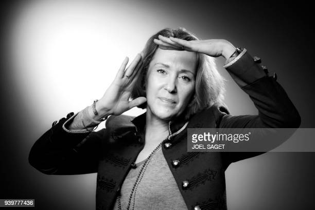 FrancoUS writer Patricia Reznikov poses during a photo session in Paris on March 18 2018 / AFP PHOTO / JOEL SAGET