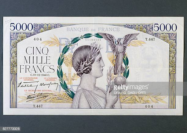 Francs banknote obverse, woman holding a statuette, allegory of Victory. France, 20th century.