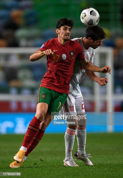 Franisco Trincao of Portugal is challenged by Sergi Roberto of Spain during the international friendly match between Portugal and Spain at Estadio...