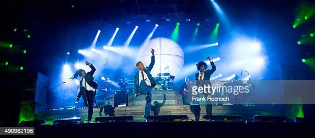 Frank A Delle, Peter Fox and Demba 'Boundzound' Nabe, singer of the German band Seeed, perform live on stage during the second day of the...