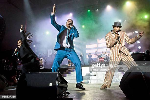 Frank A Delle, Peter Fox and Demba 'Boundzound' Nabe, singer of the band Seeed perform live during the Peace X Peace Festival at the Waldbuehne on...