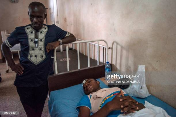 Frank AdansiBonnah a 21year old survivor lies in bed on March 20 a day after 20 students lost their life in an accident at the Waterfalls in Kintampo...