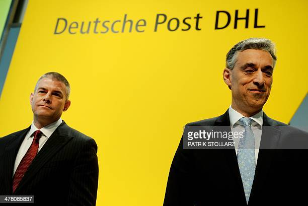 Frank Appel CEO of Deutsche Post DHL and member of the board John Gilbert arrive for the annual results press conference of his company on March 12...