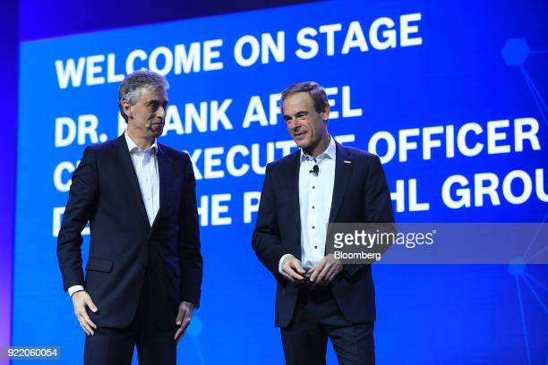 Frank Appel chief executive officer of Deutsche Post AG left stands on stage with Volkmar Denner chief executive officer of Robert Bosch GmbH during...