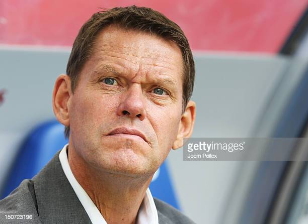 Frank Arnesen sporting director of Hamburg looks on prior the the Bundesliga match between Hamburger SV and 1 FC Nuernberg at Imtech Arena on August...