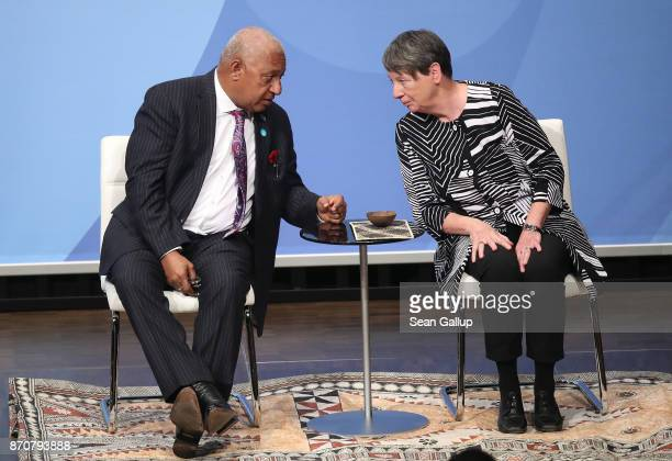 Frank Bainimarama Prime Minister of Fiji and President of the COP 23 and Barbara Hendricks German Environment Minister chat at the opening session of...