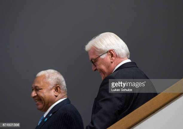 Frank Bainimarama Prime Minister of Fiji and President of the COP23 and German President FrankWalter Steinmeier arrive for a family photo during the...