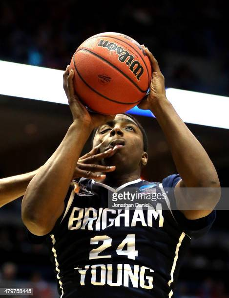 Frank Bartley IV of the Brigham Young Cougars is fouled during the second round game of NCAA Basketball Tournament against the Oregon Ducks at BMO...