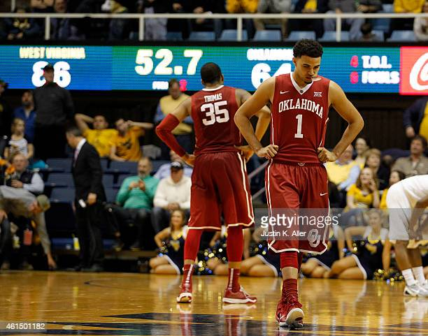 Frank Booker and TaShawn Thomas of the Oklahoma Sooners react late in the game against the West Virginia Mountaineers in the second half at the WVU...