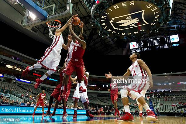 Frank Booker of the Oklahoma Sooners blocks the shot of Algie Key of the Alabama Crimson Tide during the TipOff Showcase on November 8 2013 at the...