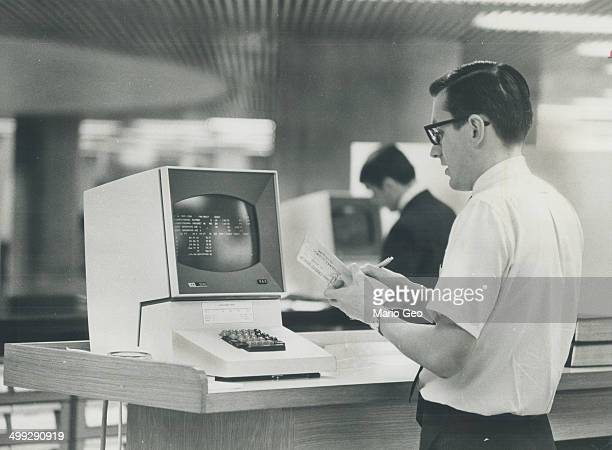 Frank booth checks the TV monitor connected to the city finance department computer If he presses a few buttons the computer will answer inquiries...
