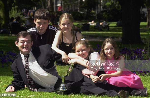 Frank Bourke a 42yearold steel worker from Corby in Northants received in London Britain's Top Dad award for being both dad and mum to his four...