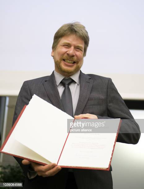 Frank Bradke, of the German Centre Neurodegenerative Diseases , is pleased with his award, during the Gottfried-Wilhelm-Leibniz-Preis awards ceremony...