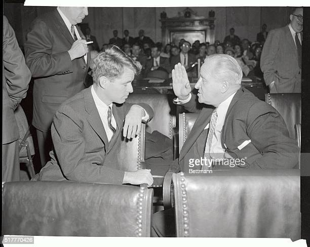 Frank Brewster, West Coat Boss of the teamsters seems to be the one who is laying down the law here as he confers with Robert Kennedy, chief counsel...