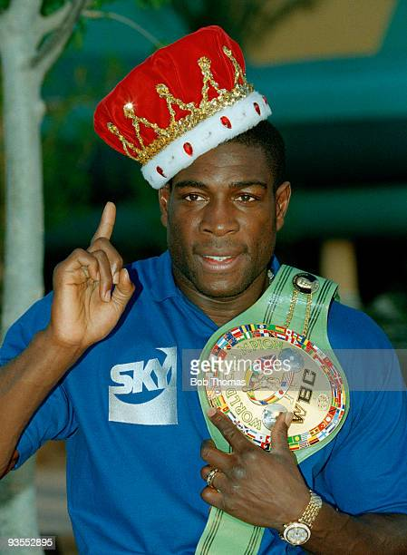 Frank Bruno of Great Britain wearing a crown and holding the WBC World Heavyweight Championship Title belt to publicise his forthcoming fight against...