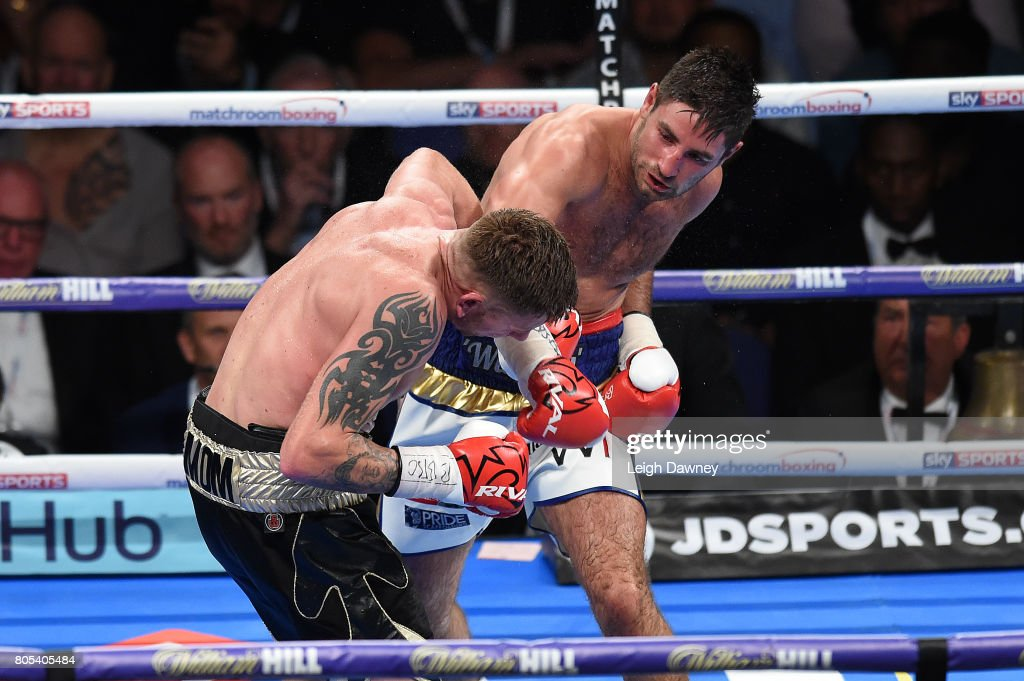 Frank Buglioni (r) in boxing action with Ricky Summers during their fight for the British Light Heavyweight Championship at The O2 Arena on July 1st, 2017 in London, England.