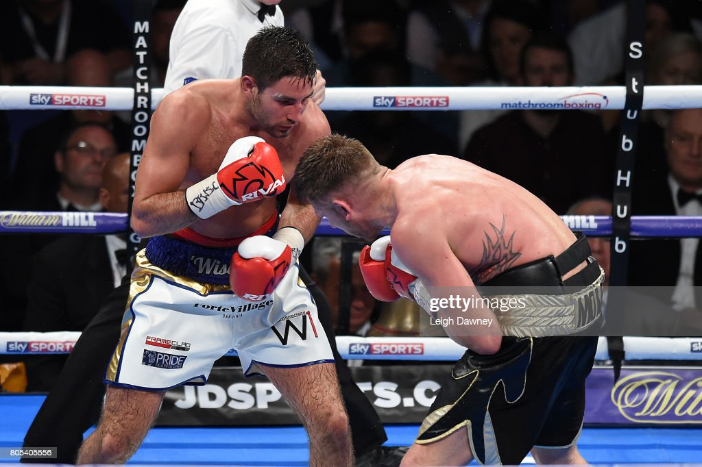 Frank Buglioni (L) in boxing action with Ricky Summers during their fight for the British Light Heavyweight Championship at The O2 Arena on July 1st, 2017 in London, England.