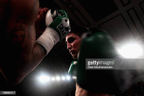 Frank Buglioni of England hits Ryan Clark of England during their Super Middleweight bout at York Hall on February 10, 2012 in London, England.