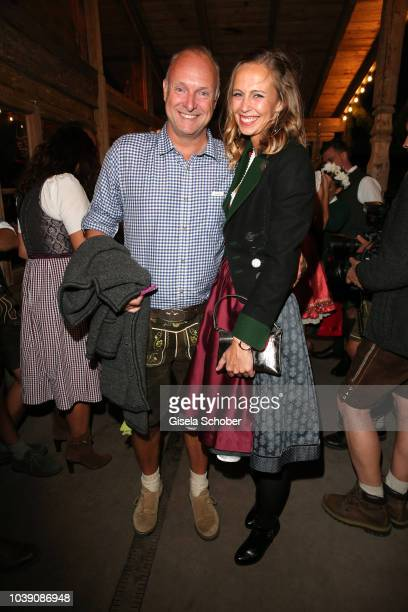 Frank Buschmann and his girlfriend Lisa Heckl during the 'Almauftrieb' as part of the Oktoberfest 2018 at Kaefer Tent at Theresienwiese on September...