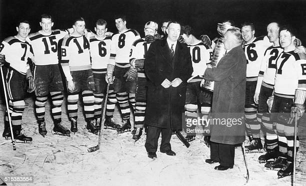 Frank Calder president of the National Hockey League presenting the Stanley Cup emblematic of the World's hockey championship to manager Art Ross of...