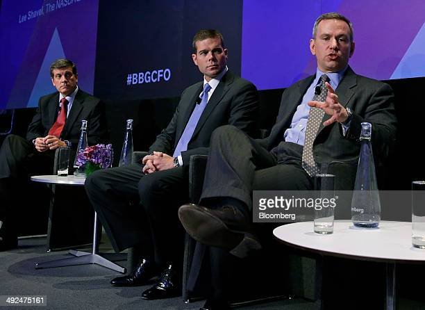 Frank Calderoni chief financial officer of Cisco Systems Inc from left John Rainey chief financial officer of United Continental Holdings Inc and Lee...