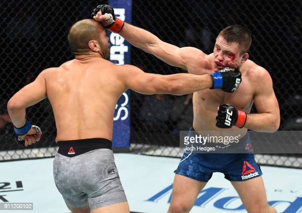 Frank Camacho of Guam exchanges punches with Drew Dober in their lightweight bout during a UFC Fight Night event at Spectrum Center on January 27...