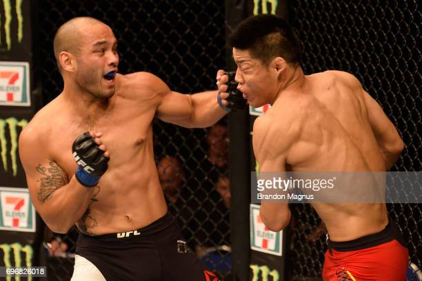 Frank Camacho of the Northern Mariana Islands punches Li Jingliang of China in their welterweight bout during the UFC Fight Night event at the...
