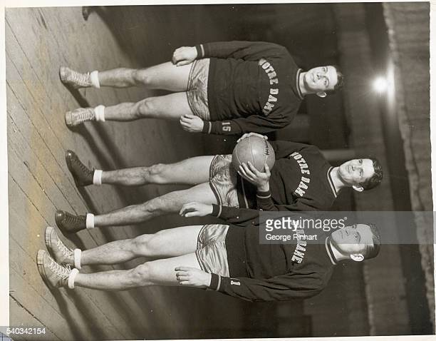 Frank Carideo O'Brien and Frank Leahy football players from the University of Notre Dame play basketball against the Knights of Columbus in a charity...