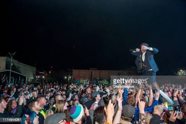 Frank Cater of Frank Carter The Rattlesnakes performs amongst the crowd while headlining the main stage on day 2 of The Legitimate Peaky Blinders...
