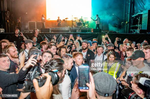 Frank Cater of Frank Carter The Rattlesnakes performs in the crowd while Dean Richardson Gareth Grover and Tom 'Tank' Barclay perform onstage...