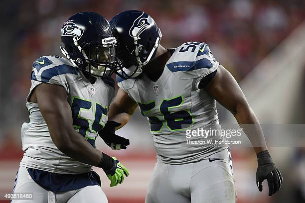 Frank Clark and Cliff Avril of the Seattle Seahawks react after a sack on Colin Kaepernick of the San Francisco 49ers during their NFL game at Levi's...