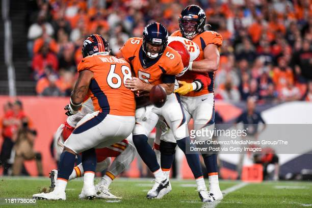 Frank Clark of the Kansas City Chiefs forces fumble on Joe Flacco of the Denver Broncos during the first quarter on Thursday, October 17, 2019.