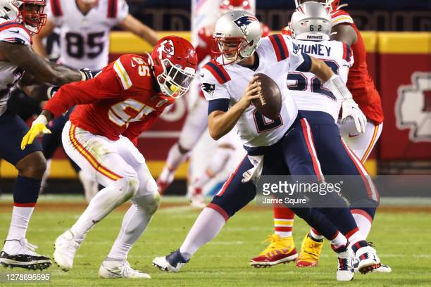 Frank Clark of the Kansas City Chiefs prepares to sack Brian Hoyer of the New England Patriots at Arrowhead Stadium on October 05, 2020 in Kansas...