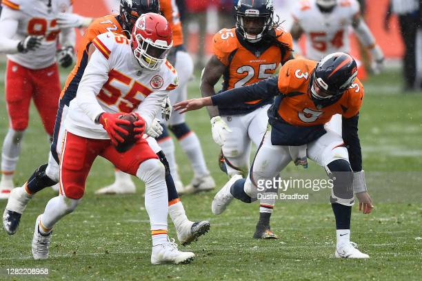 Frank Clark of the Kansas City Chiefs recovers a fumble by the Denver Broncos during their NFL game at Empower Field At Mile High on October 25, 2020...