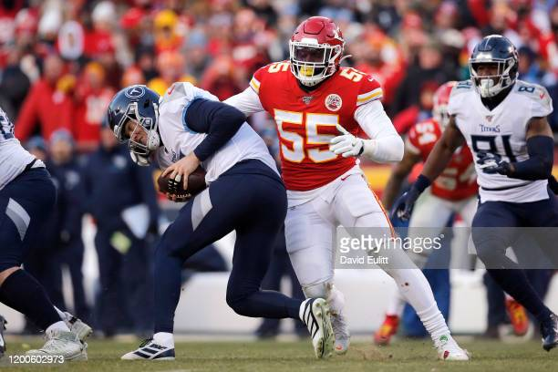Frank Clark of the Kansas City Chiefs tackles Ryan Tannehill of the Tennessee Titans for a sack in the second half in the AFC Championship Game at...